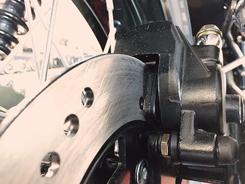 Back brake calliper, brake pad, and brake disc